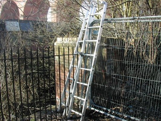 Astley Street, Stockport, Greater Manchester - ladders secured each side of railings.
